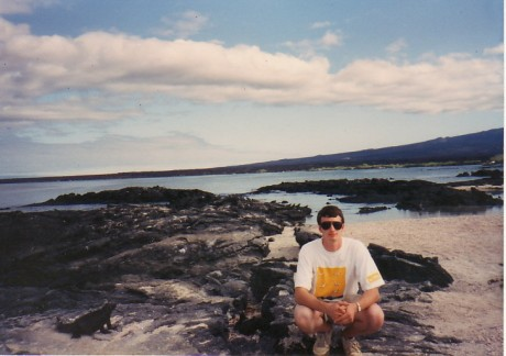 With a marine iguana in the Galapagos, 1993.