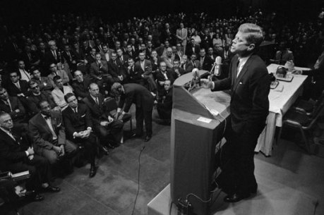 Kennedy delivering a speech about his religious views to skeptical Protestants.