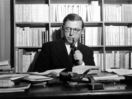 French playwright and philosopher Jean-Paul Sartre is shown in his study in Paris, on November 28, 1948.
