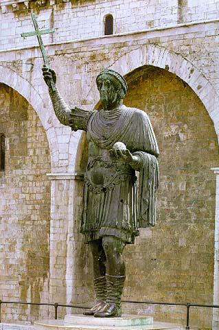 A colossal bronze statue of a Byzantine emperor at Barletta, italy. He holds a cross in one hand and the orb of the world in the other (although the arms are probably not original as their bronze was once used by Dominicans to cast bells). It is not known how exactly this statue wound up in Barletta.