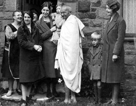 Gandhi with with textile workers at Darwen, England, September 26, 1931. Does this embody a genuine ideal of peace, or it is warfare by other means?