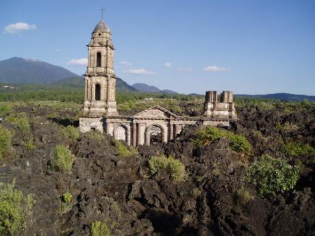 San Juan Parangaricutiro, buried under lava and ash, was abandoned during the eruption of the Parícutin volcano in 1943.