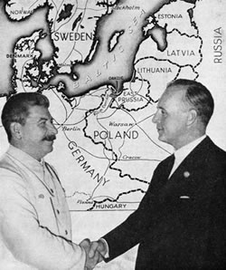Stalin and Ribbentrop shaking hands.