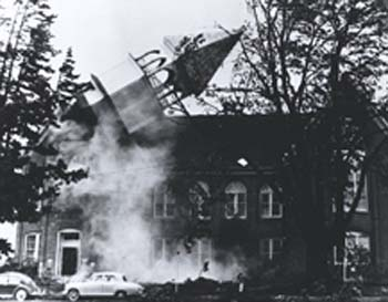 Featured in LIFE magazine, this photograph by Wes Luchau captured the collapse of the bell tower of Campbell Hall at Western Oregon State College (now Western Oregon University).