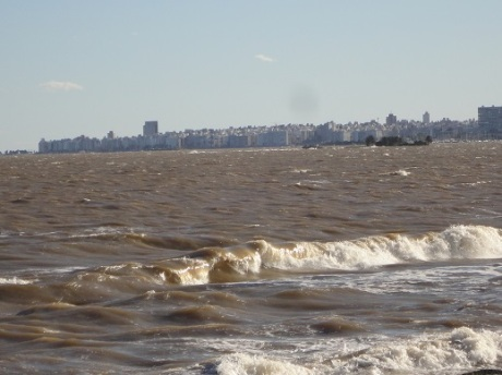 The red earth of Uruguay stirred up by the wind and the water.