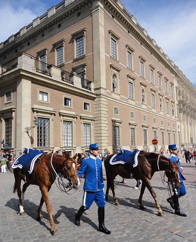 A parade of Swedish horsemen in Gamla Stan by the Royal Palace.