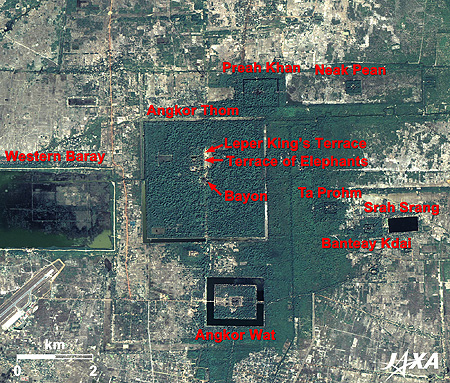 Fig. 2. The Angkor Ruins as seen on Google Earth. Figure 2 covers the entire view of Angkor. The Western Baray reservoir is visible on the left side of the image. There was a similarly large reservoir on the right, but it has since dried up. Angkor Thom, covered by green trees, is located between them. Angkor Wat is located beneath it, surrounded by a moat. Other ruins are scattered around them. (from Earth Observation Resource Center)