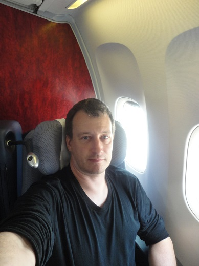 Another time flying home from Lima, and looking tired again.