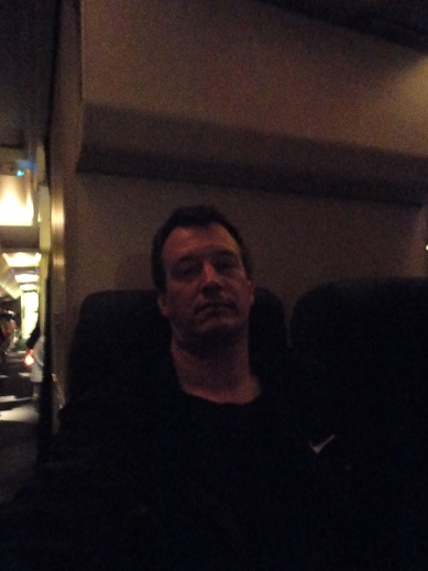 On the plane home from Lima, looking tired.