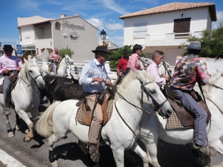 Feria du Cheval activities in the streets of Saintes-Maries-de-la-Mer.