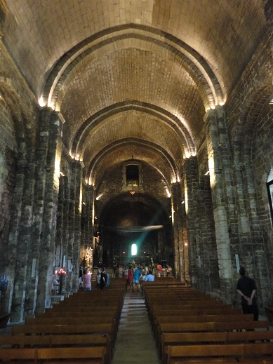 The pilgrimage church at Saintes-Maries-de-la-Mer is Romaneque in spirit, but has a transitional vault of lancet arches.