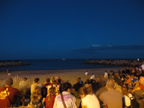 Spectators gathered on the beach at Saintes-Maries-de-la-Mer waiting for Bastille Day fireworks.