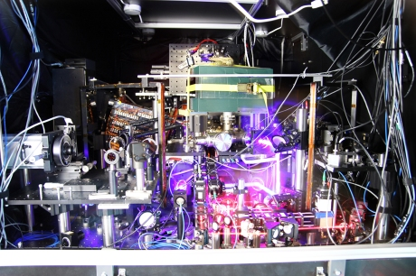 JILA's experimental atomic clock based on strontium atoms held in a lattice of laser light is the world's most precise and stable atomic clock. The image is a composite of many photos taken with long exposure times and other techniques to make the lasers more visible. (Ye group and Baxley/JILA)