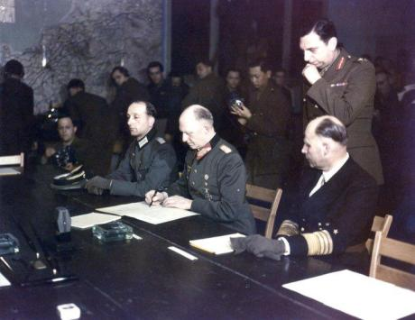 General Jodl signs the instrument for the unconditional surrender of Germany; Jodl would later hang at Nuremberg.