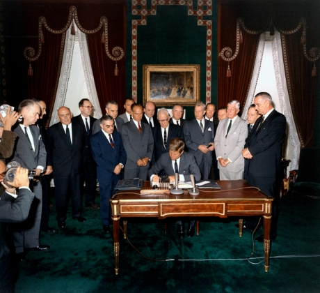 07 October 1963  President Kennedy signs the Limited Nuclear Test Ban Treaty. White House, Treaty Room. Photograph by Robert Knudsen, White House, in the John F. Kennedy Presidential Library and Museum, Boston.