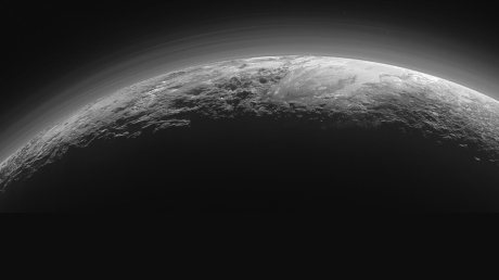 Above is the rapidly-disseminated photograph of Pluto, backlit by the sun and looking much more inviting as a planet than we perhaps expected of Pluto, from Pluto's Majestic Mountains, Frozen Plains and Foggy Hazes (http://pluto.jhuapl.edu/Multimedia/Science-Photos/pics/Pluto-Wide-FINAL-9-17-15.jpg)