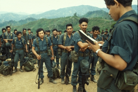 A chaplain leads a group of Contra troops in a prayer at their base camp, Honduras, 1983. The Contras refer to the loosely organized groups of Nicaraguan rebels (who were at least partially supported by the US government through the Central Intelligence Agency) who militarily opposed to the success of the socialist Sandinista political party in Nicaragua in the late 1970s and 1980s. (Photo by Steven Clevenger/Getty Images)