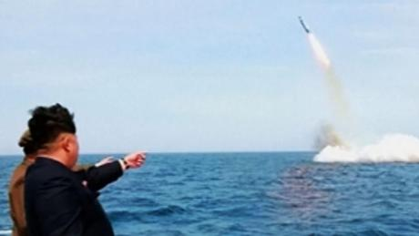 The Dear Leader watches a SLBM test.